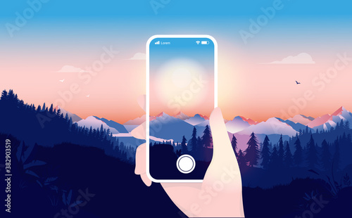 Taking nature photo with phone - Hand holding a white smartphone taking pictures of sunrise Fotobehang