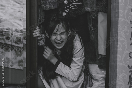 Mad scary girl in cupboard at dark night Canvas Print