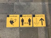 1,5 Meter Social Distancing ( Houd Afstand), Mandatory Face Masks ( Mondkapje) Wearing And Keep Right Direction (houd Rechts) Signs At Utrecht Train Station. Utrecht / Netherlands.
