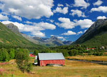 Red Wooden Barn Surrounded By ...