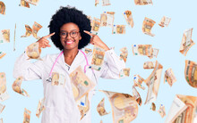 Young African American Woman Wearing Doctor Coat And Stethoscope Smiling Pointing To Head With Both Hands Finger, Great Idea Or Thought, Good Memory