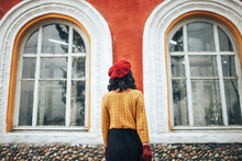Woman In Yellow Sweater And Re...