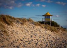 An Australian Surf Lifesavers Tower With Blue Sky And Beach In Foreground