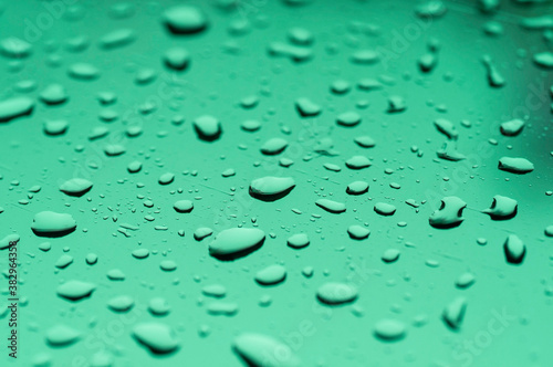Water drop on mirror reflection with light made mor color blue green violet Canvas