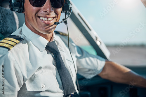 Happy young pilot ready for departuring from airport Canvas