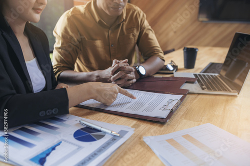 Businesswoman reading documents at meeting, business partner considering contract terms before signing checking legal contract law conditions. Selected focus
