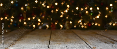 Fototapeta Christmas and New Year background banner with colorful bokeh lights and rustic wood obraz