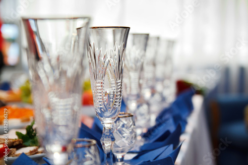 Fotografie, Obraz banquet table served with instruments and decorated with row of empty wine glass
