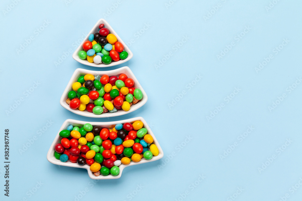 Fototapeta Christmas greeting card with fir tree shaped sweets