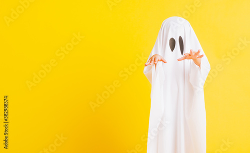 Funny Halloween Kid Concept, Closeup a little cute child with white dressed cost Canvas Print