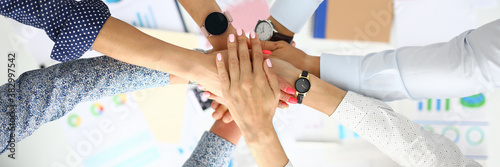 Fotografia Business people hold their hands over the table in lock