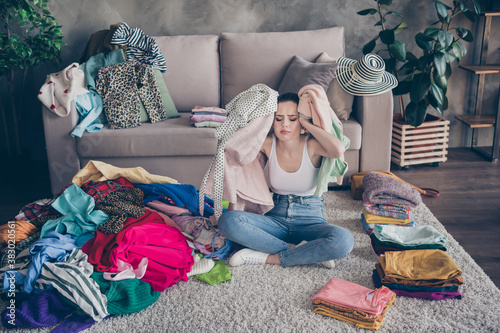 Obraz Photo of pretty stressed crying lady stay home quarantine many clothes heap stack floor wardrobe stuff pick select date outfit nothing to wear concept date preparation living room indoors - fototapety do salonu