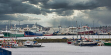 With The Marina In The Foreground, The Boats Of The Whalsay Pelagic Fishing Fleet Moored Behind And The Northlink Ferry At The Holmsgarth Terminal, A View Of Lerwick Harbour