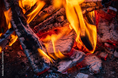 Fototapeta Burning firewood, glowing logs, fire and flames closeup photo. Burning wood for a barbecue obraz