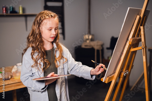 Young girl creative artist at work in a workshop Canvas Print