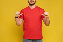 Happy Man From Delivery Service In Red T-shirt And Cap Isolated Over Yellow.
