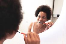 Woman Brushing Teeth Looking I...