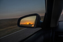 Dawn View In The Side Mirror Of A Car.
