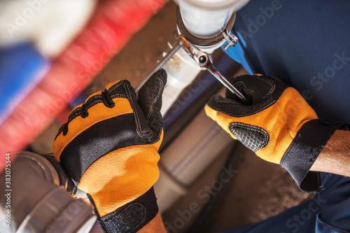 Obraz Plumber Worker Adjusting Water and Sewage System Elements - fototapety do salonu
