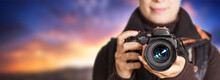 Portrait Of Unrecognizable Female Photographer Make Photography At Sunset - Panoramic Background Free Space To Use.