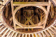 In The Attic Of A Castle, A Rounded Wooden Framework Supports The Roof.
