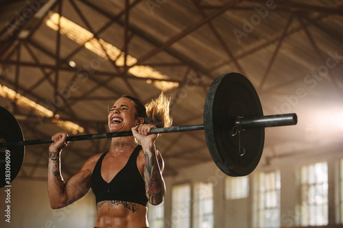 Bodybuilder woman doing weight lifting workout Canvas