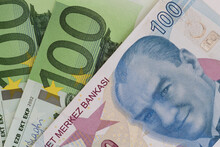 Close Up Of One Hundred Turkish Lira Banknote Against Euro Banknotes