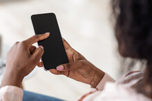 Unrecognizable African American Female Browsing Smartphone With Black Screen, Mockup Image