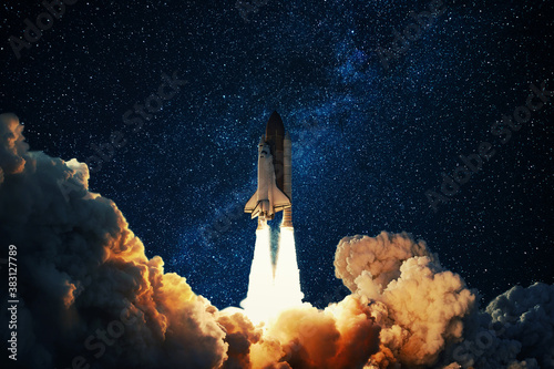 Rocket takes off in the starry sky. Spaceship begins the mission. Space shuttle taking off on a Planet Mars.