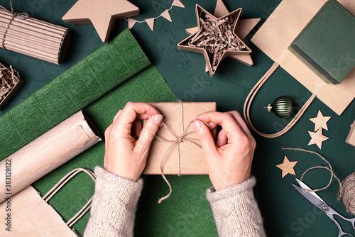 Fototapeta Female hands holding the gift box, Christmas or New Year festive composition obraz