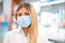 Smiling Pharmacist Wearing Cov...