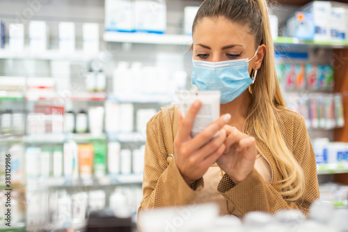 Customer checking a drug or product in a pharmacy