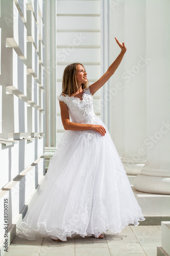 Young beautiful girl in ballroom prom dress Canvas Print