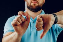 Man In Blue Short Gesturing Sm...