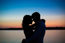 Silhouettes Of A Couple In Lov...