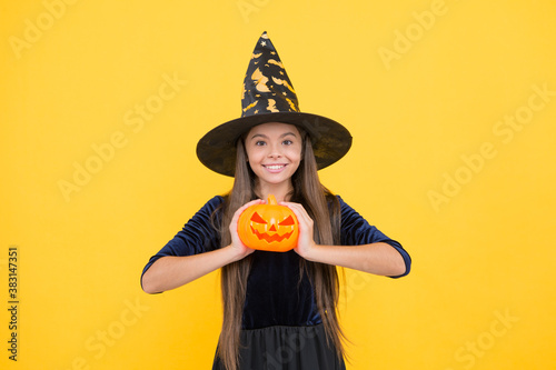 happy witch child with pumpkin jack o lantern wear costume of wizard on hallowee Canvas Print