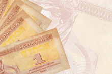 1 Ukrainian Coupon Bills Lies In Stack On Background Of Big Semi-transparent Banknote. Abstract Business Background