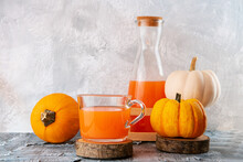 Pumpkin Orange Color Tea In Gl...