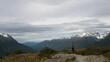 Woman hiker standing on mountaintop