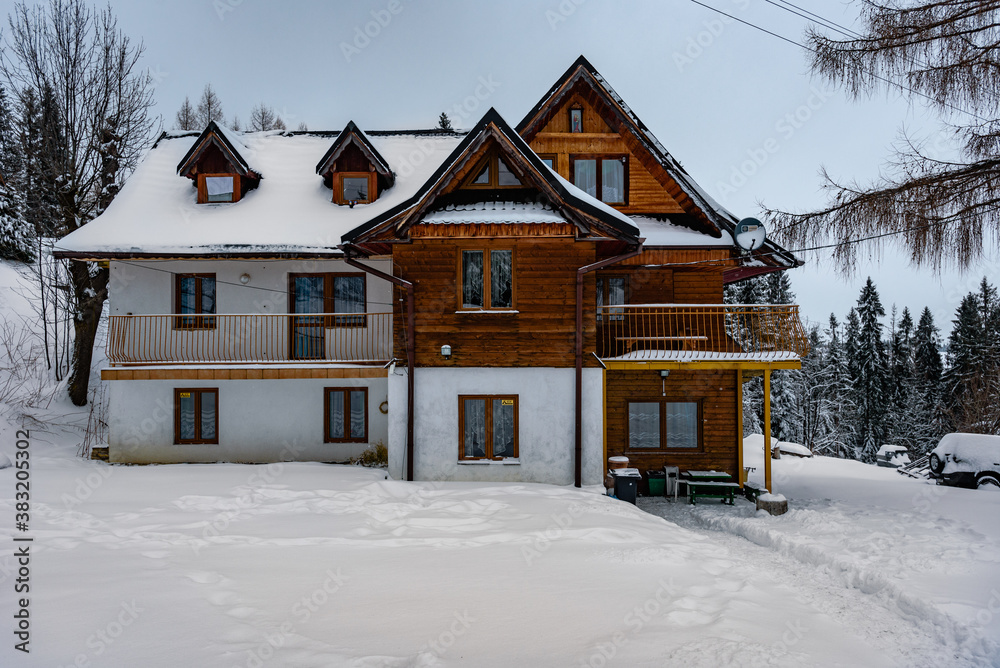 Zakopane, Poland- February 06, 2020: Mountain wooden house covered with snow