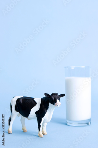 Tela glass of milk and animal shape, cow