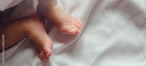Fotografie, Obraz Close-up tiny newborn baby feet on a white blanket.