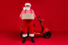Full Length Photo Of Pensioner Grandpa Moped Hold Pizza Boxes Prepare Deliver Home Client Wear Santa X-mas Costume Suspenders Sunglass Boots Striped Shirt Cap Isolated Red Color Background