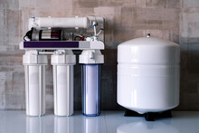 Reverse Osmosis Water Purification System At Home. Installed Water Purification Filters. Clear Water Concept