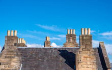 Stone Chimney Stacks With Yellow Pots