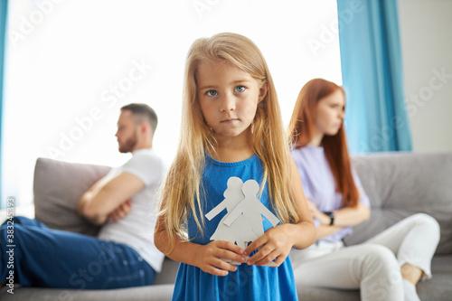 Obraz na plátně sweet little caucasian child girl holding family picture drawing feeling upset a
