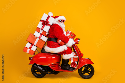Profile side view of his he nice funny fat white-haired Santa riding moped fast Canvas Print
