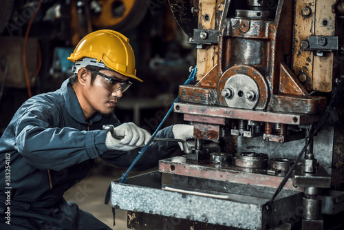 Asian engineer mechanic man checking and using wrench for maintenance pressing m Canvas