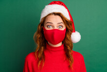 Photo Of Redhead Young Girl Staring Camera Wear Red Mask Pullover X-mas Headwear Isolated Green Color Background