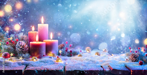 Advent - Four Purple Candles With Christmas Ornament In Shiny Night Canvas Print